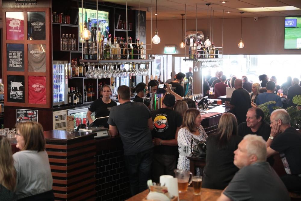 People socialising at the bar
