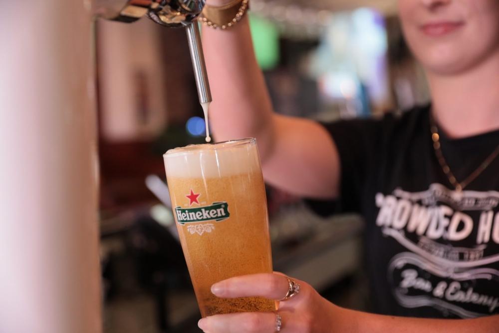 Pouring a Beer of Heineken